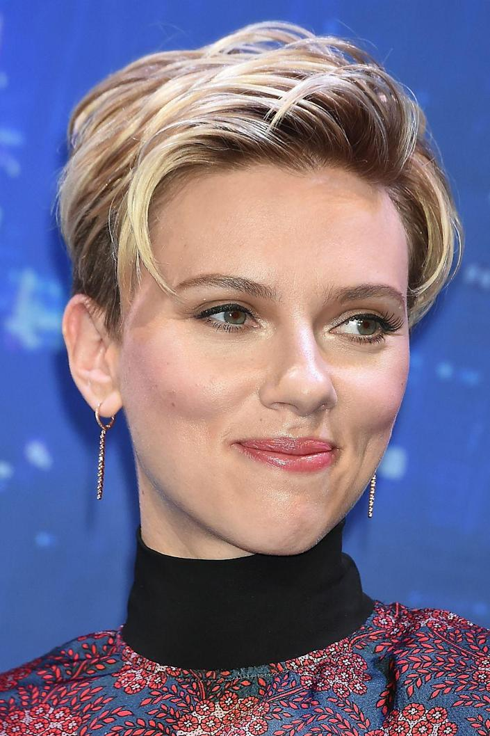 """<p>Scarlett Johansson's hair color and length has been all over the map, and mostly recently, she's been opting for a light-blonde <a href=""""http://www.goodhousekeeping.com/beauty/hair/tips/g409/celebrity-hairstyles-pixie/"""" rel=""""nofollow noopener"""" target=""""_blank"""" data-ylk=""""slk:short style"""" class=""""link rapid-noclick-resp"""">short style</a>.</p>"""