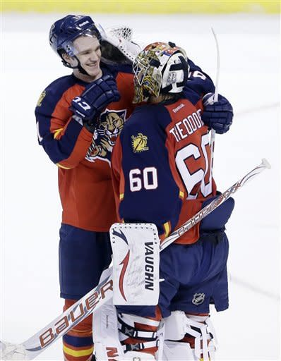 Florida Panthers goalie Jose Theodore (60) and center Jonathan Huberdeau congratulate each other after defeating the Carolina Hurricanes 5-1 in an NHL hockey game on Saturday, Jan. 19, 2013, in Sunrise, Fla. (AP Photo/Wilfredo Lee)