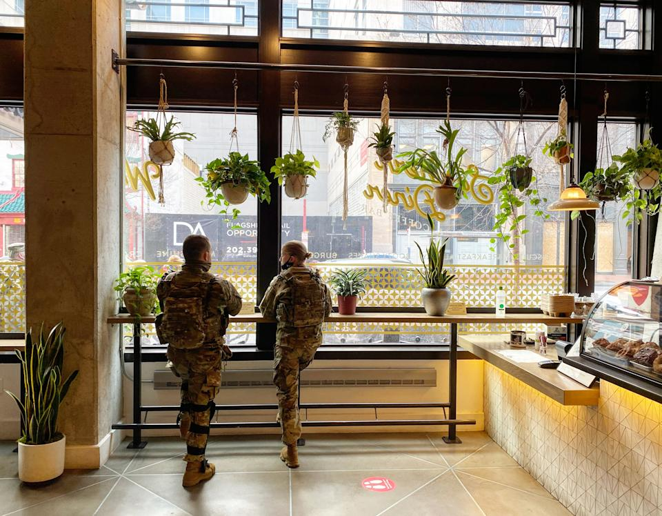 <p>Some 25,000 National Guard soldiers have arrived in Washington DC to provide security for Joe Biden's inauguration</p> (Richard Hall/The Independent )