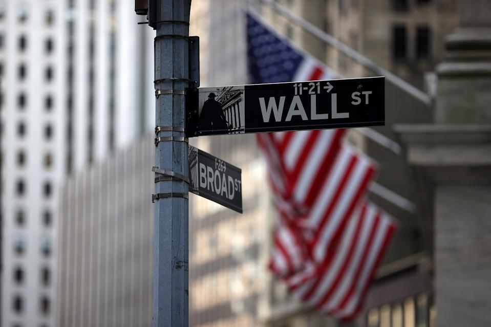 NEW YORK, NY - AOT 16: The Wall St. and Broad St. signs are seen by the New York Stock Exchange (NYSE) building in the financial district of New York City, United States on August 16, 2021. ( Photo by Tayfun Coskun / Anadolu Agency via Getty Images)