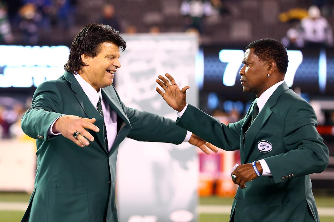 EAST RUTHERFORD, NJ - OCTOBER 08:  (L-R) Former New York Jets All-Pro defensive lineman Mark Gastineau and former Jets wide receiver Wesley Walker participate in a haltime ceremony inducting them into the Jets' Ring of Honor against the Houston Texans at MetLife Stadium on October 8, 2012 in East Rutherford, New Jersey.  (Photo by Al Bello/Getty Images)