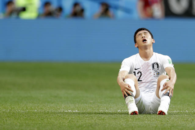 South Korea's Kim Min-woo sits on the pitch at the end of the group F match between Sweden and South Korea at the 2018 soccer World Cup in the Nizhny Novgorod stadium in Nizhny Novgorod, Russia, Monday, June 18, 2018. Sweden won 1-0. (AP Photo/Petr David Josek)