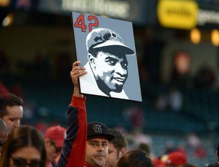 FILE PHOTO: Apr 15, 2014; Anaheim, CA, USA; A fan of the Los Angeles Angels holds a picture of Jackie Robinson with the No. 42 during the game against the Oakland Athletics at Angel Stadium of Anaheim. Mandatory Credit: Kirby Lee-USA TODAY Sports - 7872522