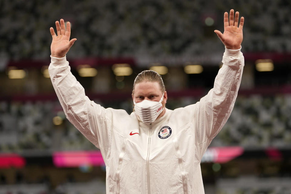 Gold medalist Ryan Crouser, of the United States, waves during the medal ceremony for the men's shot put at the 2020 Summer Olympics, Thursday, Aug. 5, 2021, in Tokyo. (AP Photo/Martin Meissner)