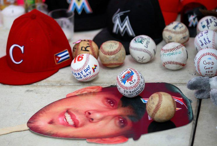 Baseballs and other memorabilia are left at a makeshift memorial created by fans mourning the death due to a boating accident of Miami Marlins pitcher Jose Fernandez, outside Marlins Park prior to a game against the New York Mets in Miami, Florida, September 26, 2016. (Andrew Innerarity/Reuters)