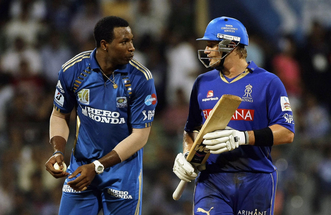 Rajasthan Royals' Shane Watson and Mumbai Indians' Kieron Pollard interact during the Indian Premier League (IPL) cricket match in Mumbai, India, Friday, May 20, 2011.