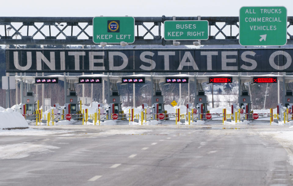 The border crossing into the United States is seen during the COVID-19 pandemic in Lacolle, Quebec, on Friday, Feb. 12, 2021. Tighter border controls will come into effect Feb. 22, the prime minister said Friday, not to punish travelers but to try to keep everyone safe. (Paul Chiasson/The Canadian Press via AP)
