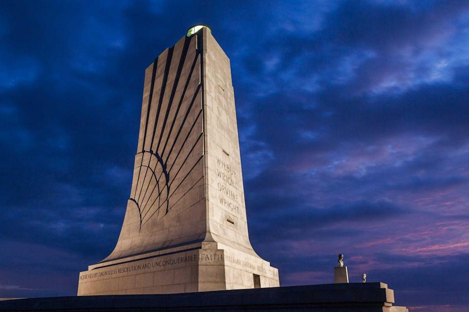 """<p><strong>Wright Brothers National Memorial</strong></p><p>The Wright-Patterson Air Force Base located in Dayton, Ohio, is where Wilbur and Orville Wright worked on their aircraft and learned how to fly. The <a href=""""https://www.nps.gov/wrbr/index.htm"""" rel=""""nofollow noopener"""" target=""""_blank"""" data-ylk=""""slk:memorial"""" class=""""link rapid-noclick-resp"""">memorial</a>, which was first built in 1940, is a sight to be seen (and lit at night beautifully) and can be found on Wright Brothers Hill.</p>"""