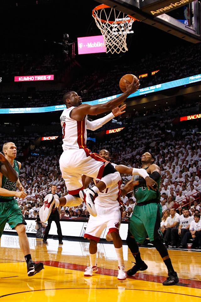 MIAMI, FL - MAY 28:  Dwyane Wade #3 of the Miami Heat drives for a shot attempt in the second half against Paul Pierce #34 of the Boston Celtics in Game One of the Eastern Conference Finals in the 2012 NBA Playoffs on May 28, 2012 at American Airlines Arena in Miami, Florida.  NOTE TO USER: User expressly acknowledges and agrees that, by downloading and or using this photograph, User is consenting to the terms and conditions of the Getty Images License Agreement.  (Photo by Mike Ehrmann/Getty Images)