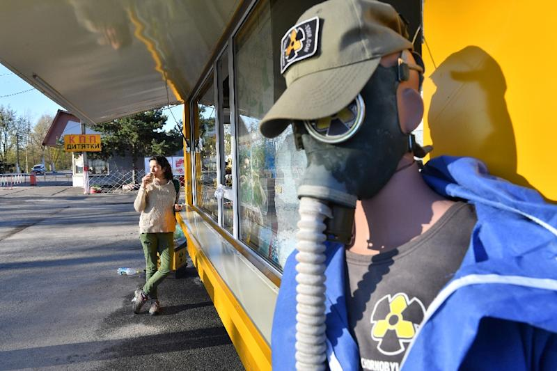 A souvenir kiosk at the main entrance to the exclusion zone sells T-shirts and fridge magnets with the black-and-yellow radiation warning symbol as well as Soviet-era gas masks (AFP Photo/Sergei SUPINSKY)