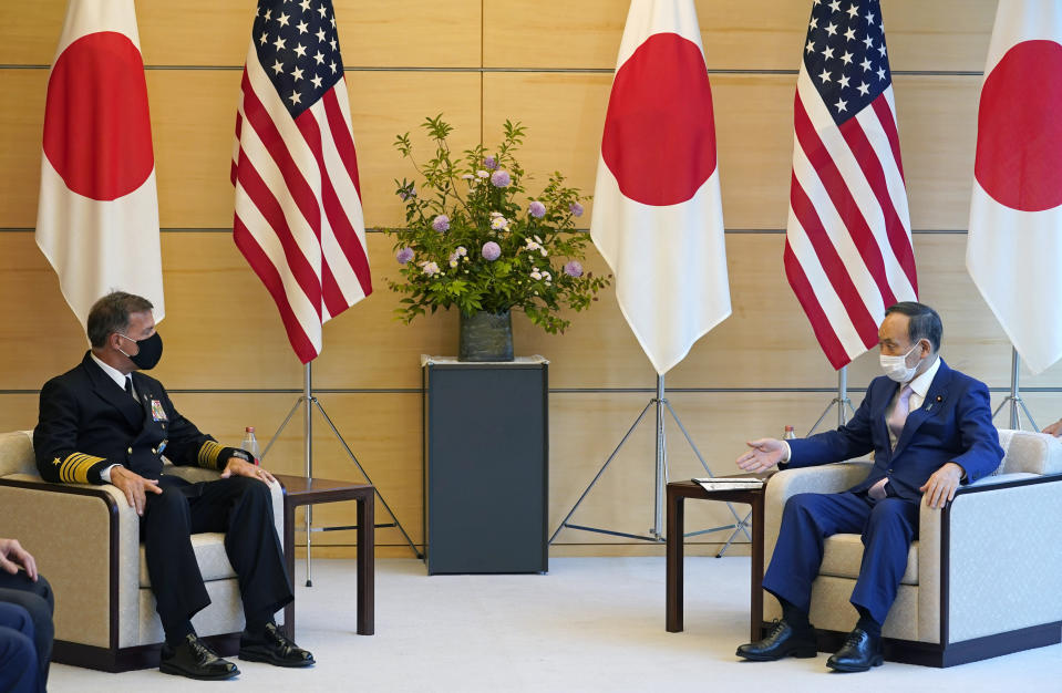Admiral John C. Aquilino, left, Commander of the United States Indo-Pacific Command, listens to Japanese Prime Minister Yoshihide Suga at the start of their meeting at the prime minister's official residence in Tokyo, Japan, Tuesday, June 1, 2021. (Franck Robichon/Pool Photo via AP)