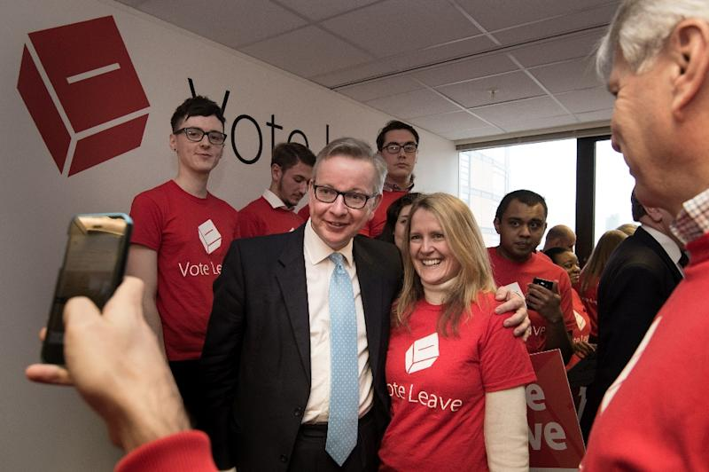 Lord Chancellor and Justice Secretary Michael Gove (C) poses for a picture with an activist as he attends the launch of the eurosceptic 'Vote Leave' campaign in central London on February 20, 2016 (AFP Photo/Stefan Rousseau)