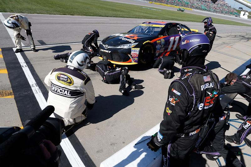 Denny Hamlin's car apparently hit something early in the race to break the splitter. (Getty)
