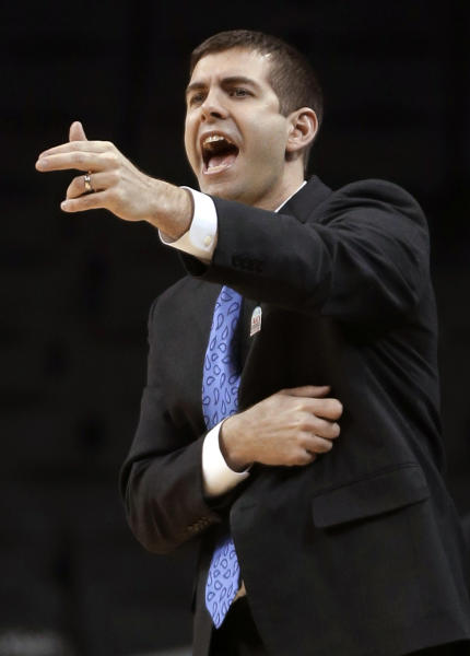FILE - In this March 14, 2013, file photo, Butler coach Brad Stevens talks to players during an NCAA college basketball game against Dayton at the Atlantic 10 Conference tournament in New York. The Boston Celtics announced Wednesday, July 3, 2013, that Stevens has been hired as the NBA basketball team's coach, replacing Doc Rivers, who was traded to the Los Angeles Clippers. (AP Photo/Seth Wenig, File)