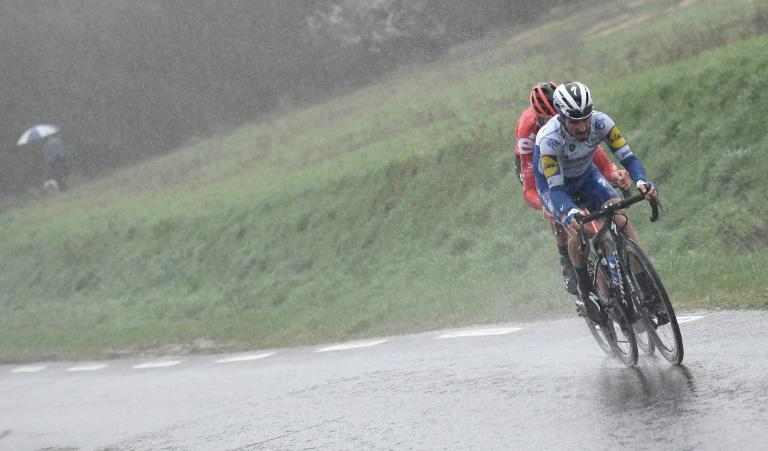 In the last major stage race in Europe, the Paris-Nice in February, Tiesj Benoot and Julian Alaphilippe raced in wintry conditions (AFP Photo/Alain JOCARD)
