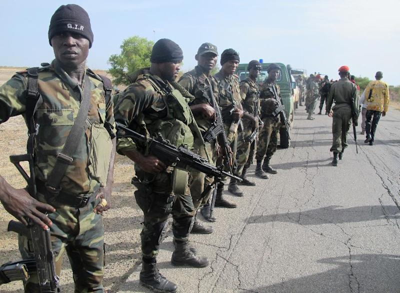 Cameroonian soldiers deploy as reinforcements against Nigerian Islamist group Boko Haram, in Dabanga, Cameroon, on June 17, 2014