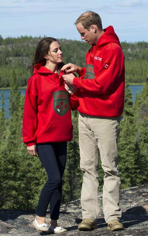 <p>Wearing matching Canadian Rangers sweaters, after being made honourary members, the couple looked more comfortable than ever before during this photocall. <br /><em>[Photo: PA]</em> </p>