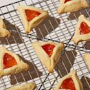 """<p>These shortbread-like cookies filled with jam are traditionally served around the Jewish holiday of Purim.</p><p><em><a href=""""https://www.delish.com/cooking/recipe-ideas/a31959676/hamantaschen-recipe/"""" rel=""""nofollow noopener"""" target=""""_blank"""" data-ylk=""""slk:Get the recipe from Delish »"""" class=""""link rapid-noclick-resp"""">Get the recipe from Delish »</a></em></p>"""
