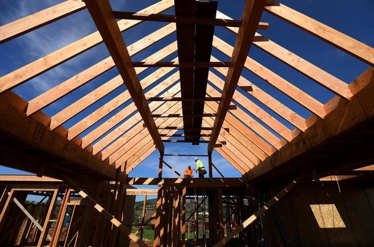 FILE PHOTO - Construction workers build a single family home in San Diego California
