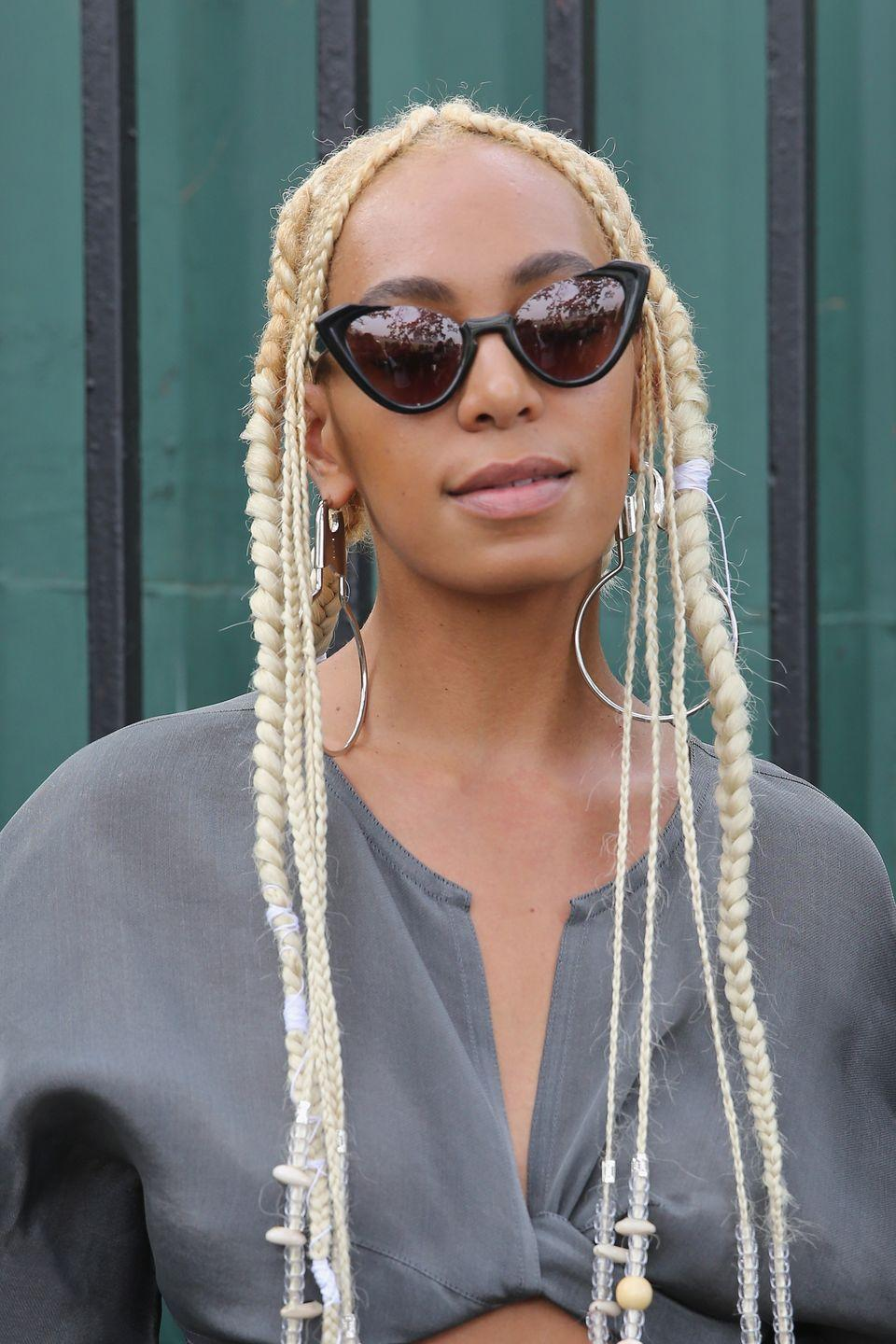 <p>The singer worked extra long bleached blonde braids.</p>