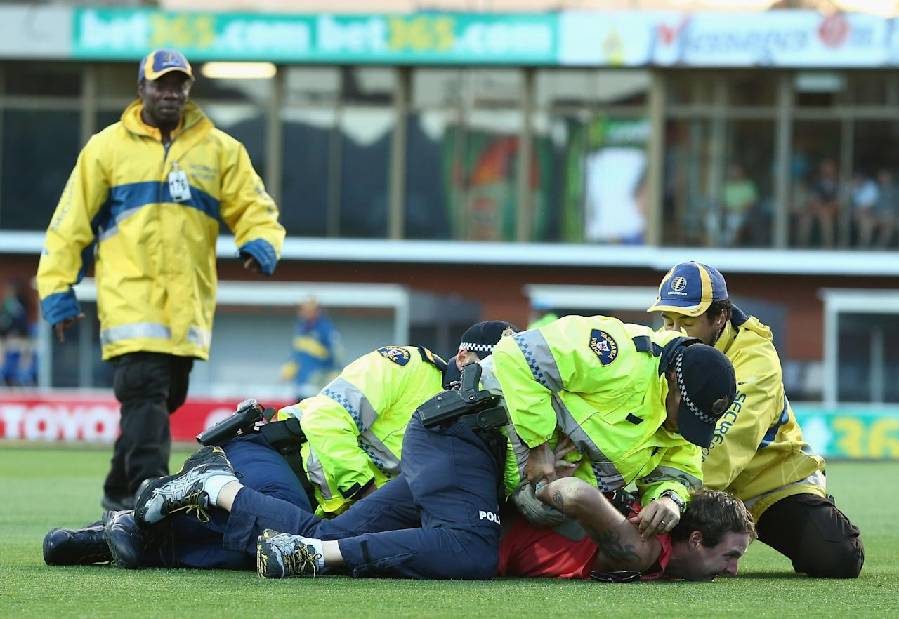HOBART, AUSTRALIA - JANUARY 23:  A pitch invader is arrested by police during game five of the Commonwealth Bank One Day International Series between Australia and Sri Lanka at Blundstone Arena on January 23, 2013 in Hobart, Australia.  (Photo by Robert Cianflone/Getty Images)