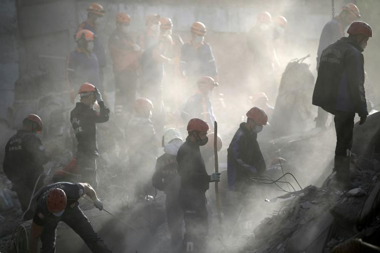 Racing against time, rescue workers were pressing ahead with their desperate search for survivers more than 72 hours after disaster struck