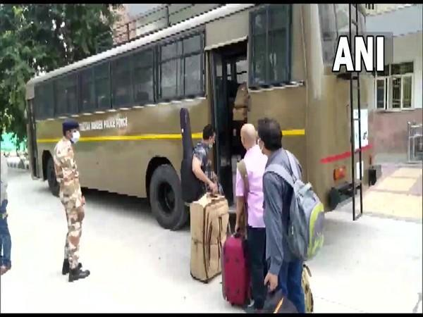 Visuals of evacuees discharged from ITBP Chhawla Camp, New Delhi after 14-day quarantine