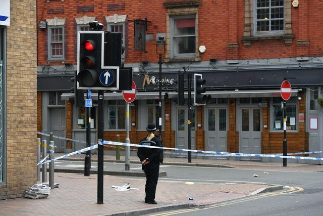 A police officer at a cordon in Hurst Street in Birmingham