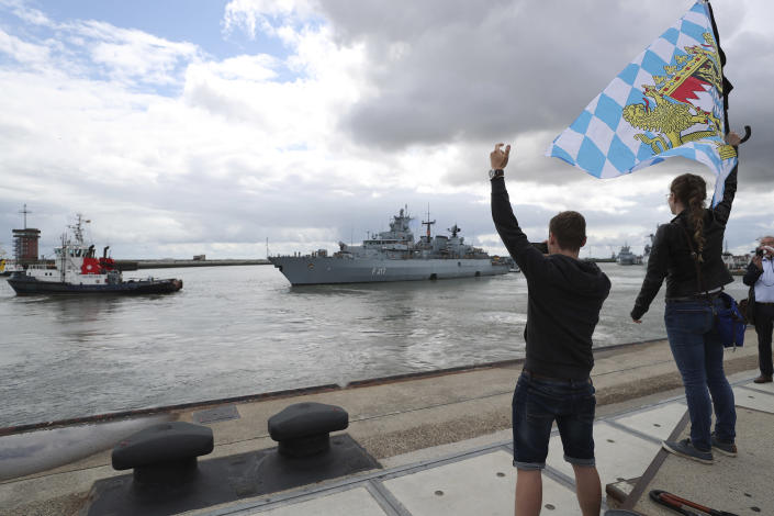 In this photo released by the Bundeswehr, well-wishers wave as Germany's naval frigate Bayern leaves the port of Wilhelmshaven, Germany, Aug. 2, 2021. Heading for the Indo-Pacific region, the crew will be underway for more than six months. (Nico Theska/Bundeswehr via AP)