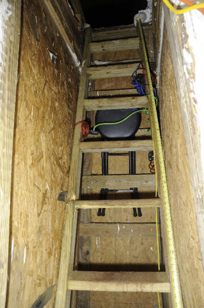 This February 2013 photo provided by the FBI shows a ladder in the underground bunker of Jimmy Lee Dykes who kept authorities at bay during a six-day bunker hostage standoff, near Midland City, Ala. An FBI hostage rescue team stormed the bunker in early February, killing Dykes before he harmed his 5-year-old hostage or detonated an improvised explosive that authorities said was in the 6-foot by 8-foot shelter. (AP Photo/FBI)