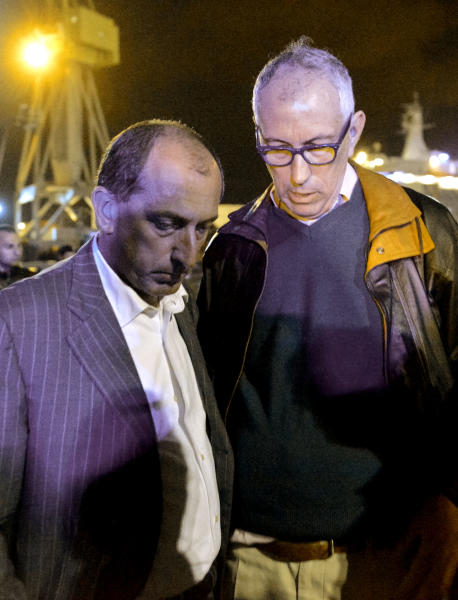 Genoa's harbor President Luigi Merlo, left, and the head of the harbor pilots Giovanni Lettich meet on the dock where the cargo ship Jolly Nero hit and toppled the control tower of the port of Genoa killing at least three people, Tuesday, May 7, 2013. A half-dozen people remain unaccounted for early Wednesday, after a cargo ship identified as the Jolly Nero of the Ignazio Messina & C. SpA Italian shipping line, slammed into the port. (AP Photo/Marco Balostro)