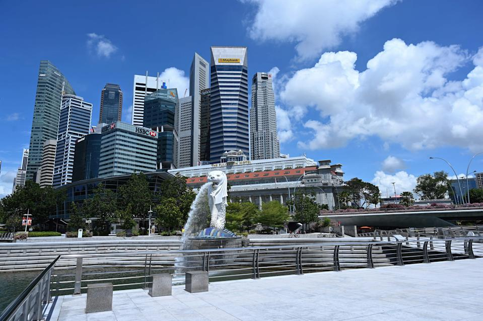 A general view shows the Singapore skyline behind the Merlion park on May 15, 2020. (Photo by Roslan RAHMAN / AFP) (Photo by ROSLAN RAHMAN/AFP via Getty Images)