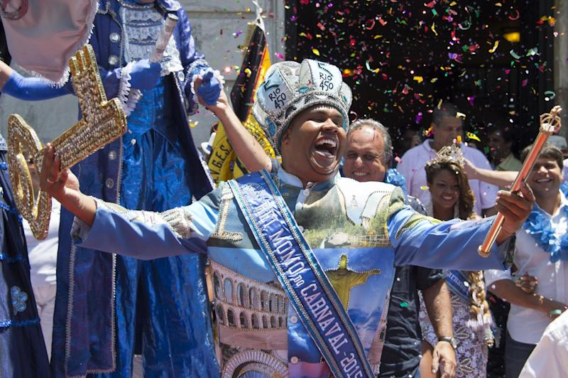 Carnival King Momo, Wilson Dias da Costa Neto, celebrates upon receiving the keys to the city from Rio's mayor during the official launching of the 2015 Carnival in Rio de Janeiro, Brazil, on February 13, 2015