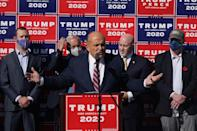 <p>Giuliani was incredulous Saturday at the news that Biden was projected to defeat Trump in the election.</p> <p>He spoke (right, center) at a news conference in the parking lot of a landscaping company in Philadelphia Saturday where he suggested it would be the courts who would ultimately settle the race, though he did not provide evidence of wrongdoing.</p>