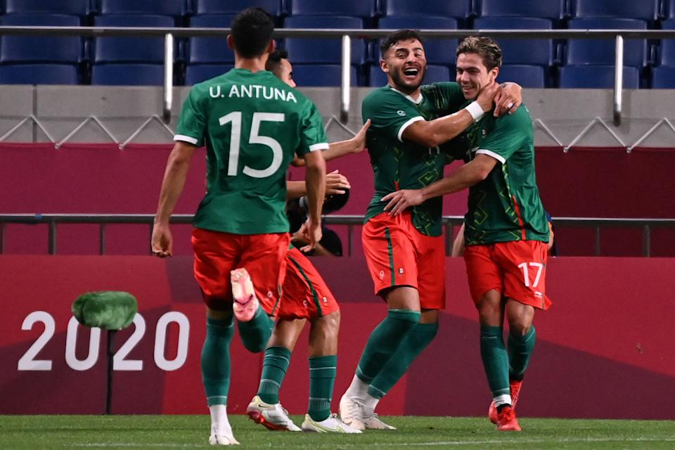Mexico's players celebrate their third goal during the Tokyo 2020 Olympic Games men's bronze medal football match between Mexico and Japan at Saitama Stadium in Saitama on August 6, 2021. (Photo by Jonathan NACKSTRAND / AFP) (Photo by JONATHAN NACKSTRAND/AFP via Getty Images)