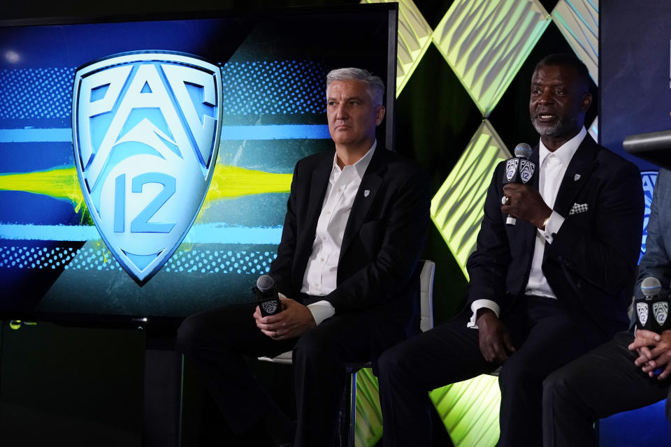 Pac-12 Commissioner George Kliavkoff, center, and Senior Associate Commissioner for Football Operations Merton Hanks field questions during the Pac-12 Conference NCAA college football Media Day Tuesday, July 27, 2021, in Los Angeles. (AP Photo/Marcio Jose Sanchez)