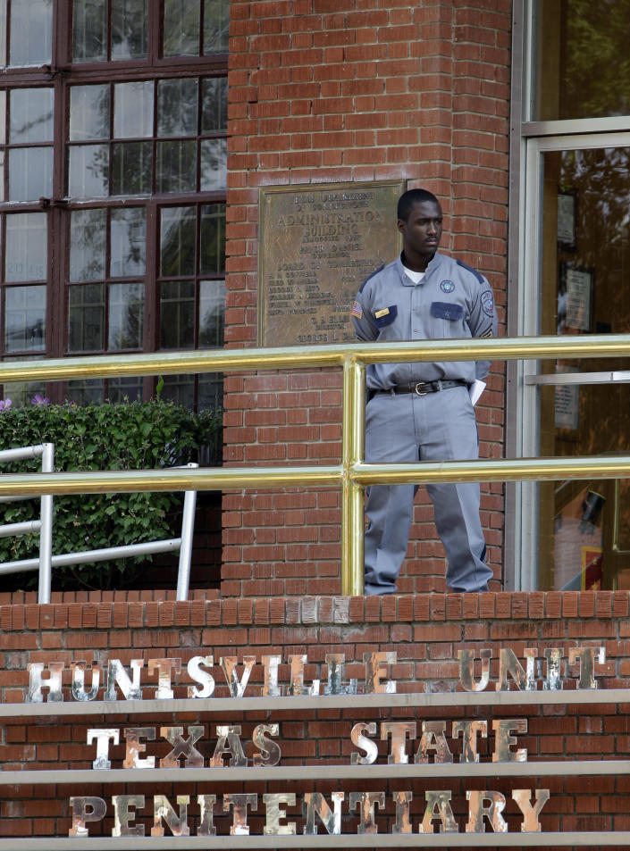 FILE - In this Sept. 21, 2011 file photo, a corrections officer keeps watch outside the Texas Department of Criminal Justice Huntsville Unit in Huntsville, Texas. On Wednesday, April 2, 2014, a federal appeals court threw out a ruling requiring the Texas prison system to disclose more information about where it gets lethal-injection drugs, reversing a judge who had halted an upcoming execution. (AP Photo/David J. Phillip, File)