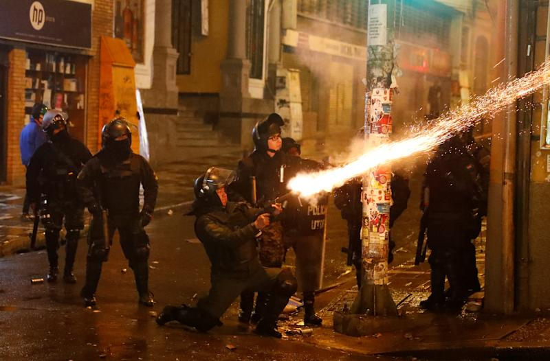 Police fire a weapon during clashes between protesters against Bolivia's President Evo Morales and government supporters, in La Paz, Bolivia Nov. 7, 2019. (Photo: Kai Pfaffenbach/Reuters)