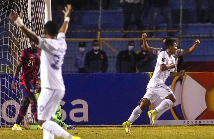 Honduras's Brayan Velasquez, right, celebrates scoring his side's opening goal against United States during a qualifying soccer match for the FIFA World Cup Qatar 2022, in San Pedro Sula, Honduras, Wednesday, Sept. 8, 2021. (AP Photo/Moises Castillo)