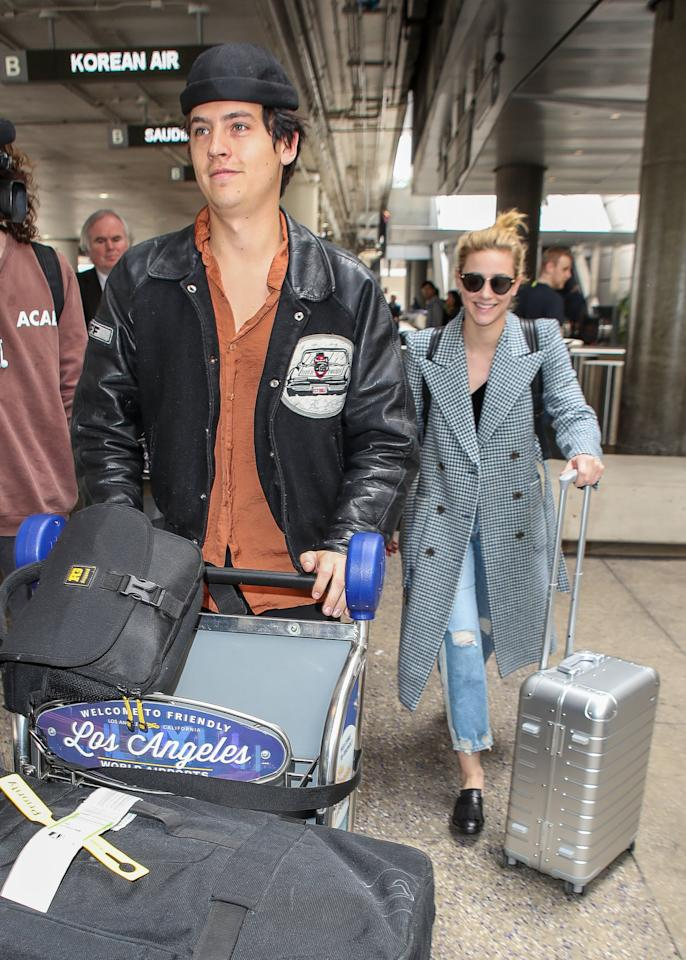 <p>Lili and Cole's off-duty style reminds us of something Betty and Jug would wear. Cole's leather jacket and black beanie is totally a Jughead look. Meanwhile, Lili's smart overcoat and loafers complement Betty's preppy style, but Lili looks way cooler. </p>