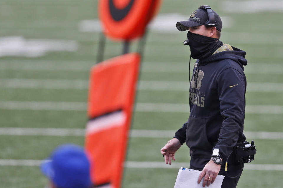 Cincinnati Bengals head coach Zac Taylor watches the second half of an NFL football game against the New York Giants, Sunday, Nov. 29, 2020, in Cincinnati. (AP Photo/Aaron Doster)