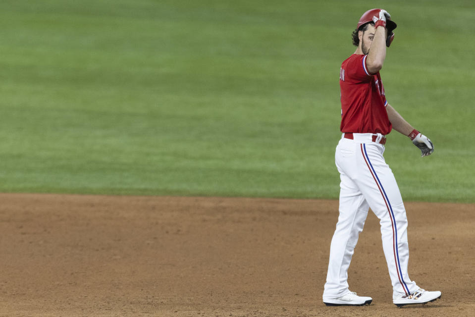 Texas Rangers' Charlie Culberson reacts after hitting a popout to end the eighth inning of a baseball game against the Minnesota Twins in Arlington, Texas, Friday, June 18, 2021. (AP Photo/Andy Jacobsohn)