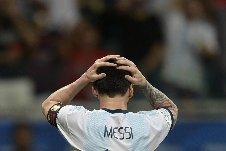 Argentina's Lionel Messi gestures after missing a goal opportunity against Colombia during their Copa America football tournament group match at the Fonte Nova Arena in Salvador, Brazil, on June 15, 2019. (Photo by Juan MABROMATA / AFP)        (Photo credit should read JUAN MABROMATA/AFP/Getty Images)