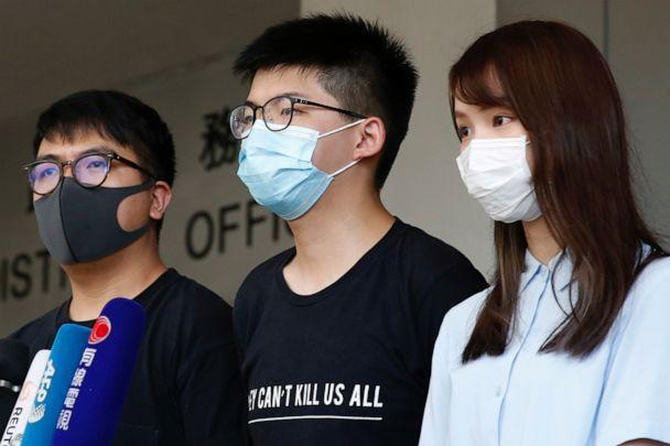 PHOTO: Pro-democracy activists Ivan Lam, Joshua Wong and Agnes Chow arrive to the Eastern Court for hearing in Hong Kong, China July 6, 2020. (Tyrone Siu/Reuters)