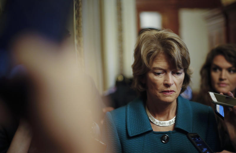 File - In this Oct. 4, 2018 file photo, Sen. Lisa Murkowski, R-Alaska, pauses while speakings to members of the media after a vote to advance Brett Kavanaugh's nomination to the Supreme Court, on Capitol Hill. Alaska Republican party leaders plan to consider whether to reprimand Murkowski for opposing Kavanaugh's confirmation. The party has asked Murkowski to provide any information she might want its state central committee to consider. Murkowski told reporters that if she worried about political repercussions she wouldn't be able to do the job Alaskans expect her to do. (AP Photo/Pablo Martinez Monsivais, File)