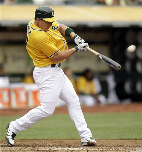 Oakland Athletics' Brandon Inge hits an RBI-sacrifice fly off Los Angeles Dodgers' Clayton Kershaw in the second inning of a baseball game on Thursday, June 21, 2012, in Oakland, Calif. (AP Photo/Ben Margot)