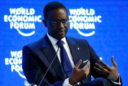 """Tidjane Thiam, Chief Executive Officer of Swiss bank Credit Suisse attends the session """"The Global Economic Outlook"""" during the annual meeting of the World Economic Forum (WEF) in Davos, Switzerland January 23, 2016. REUTERS/Ruben Sprich/File Photo"""