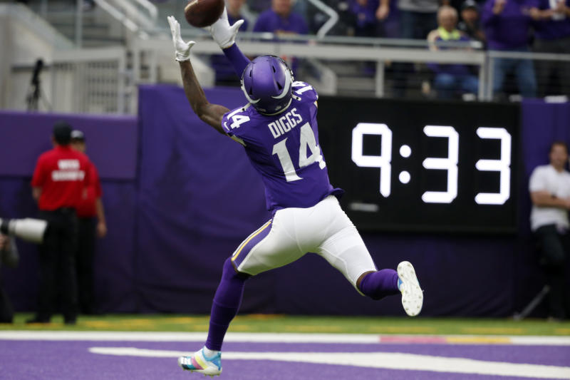 Minnesota Vikings wide receiver Stefon Diggs catches a 51-yard touchdown pass during the first half of an NFL football game against the Philadelphia Eagles, Sunday, Oct. 13, 2019, in Minneapolis. (AP Photo/Bruce Kluckhohn)