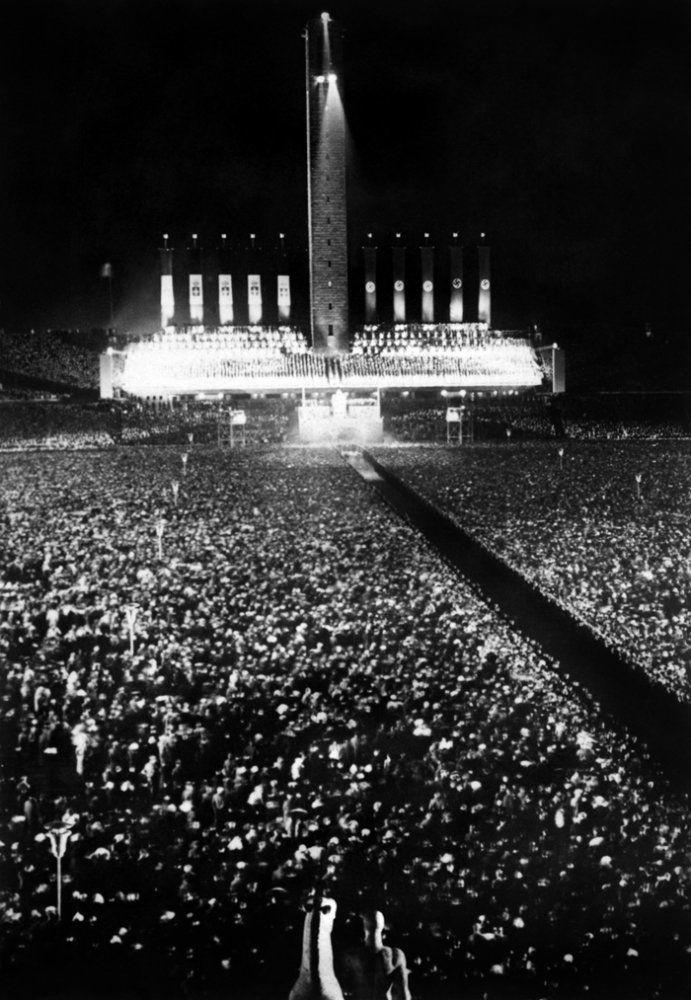 One million people gather in Berlin's Olympic Stadium and adjoining Mayfield, 28 September 1937, to hear speeches of German führer Adolf Hitler and Italian leader Benito Mussolini, who claim the alliance between Italy and Germany. Benito Mussolini visited Germany and his führer Adolf Hitler in September and October 1937. (Photo credit should read OFF/AFP/Getty Images)