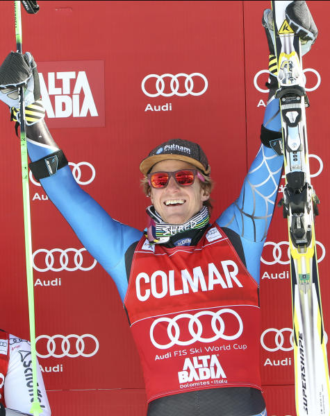 Ted Ligety, of the United States, celebrates on the podium after winning an alpine ski, men's World Cup giant slalom, in Alta Badia, Italy, Sunday, Dec. 16, 2012. (AP Photo/Alessandro Trovati)